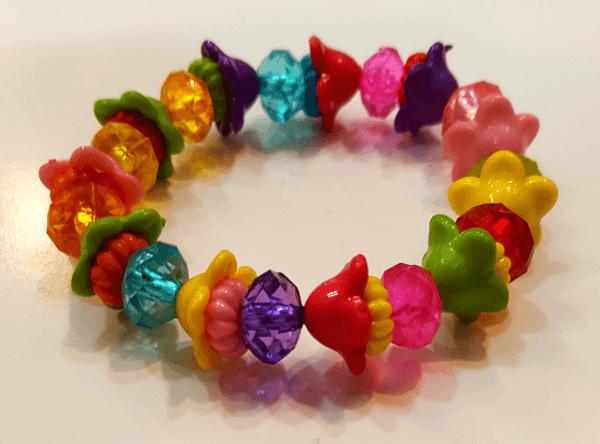 دستبند دخترانه پلاستیکی گل شیپوری